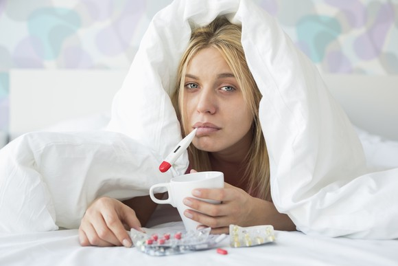 woman-sick-in-bed-flu-thermometer-medicine-getty_large.jpg